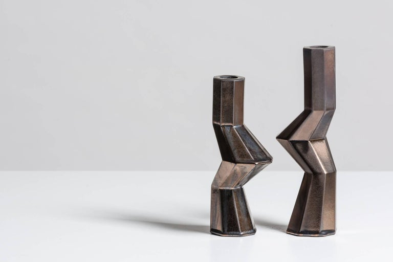 Lara Bohinc continues to work with ancient and futuristic forms with new Fortress designs, further exploring the complex geometry of this range. The hexagonal shapes interlock and embrace, creating a dynamic play of light and shade on the many