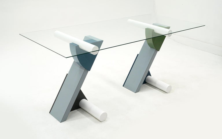 The fortune glass top table / desk designed by Michele de Lucchi for Memphis, Milano, Italy, 1982. Constructed of blue, green and gray laminate, lacquered wood and glass. This a rare early original example.