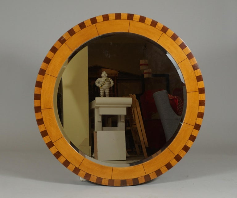 Stunning, large inlaid framed mirror. Diameter 42 inches.