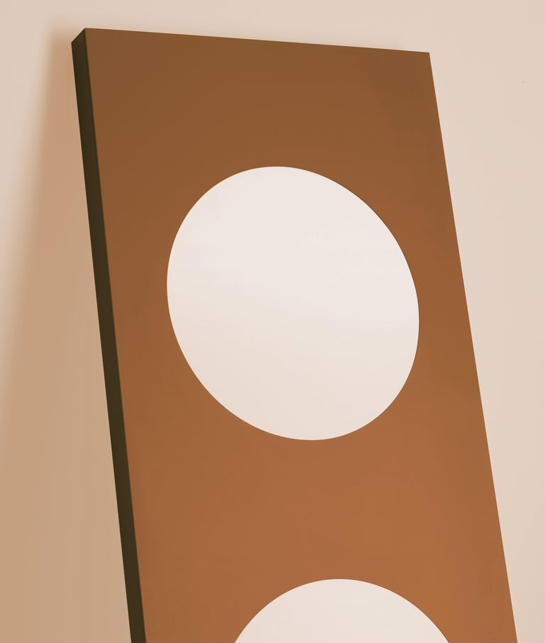 Floor lamp for installation resting against a wall for diffused and reflected light. The lamp consists of a laser-cut sheet of aluminum bent using a pressure bending machine and hand-finished. The aluminum is anodized and subsequently liquid coated