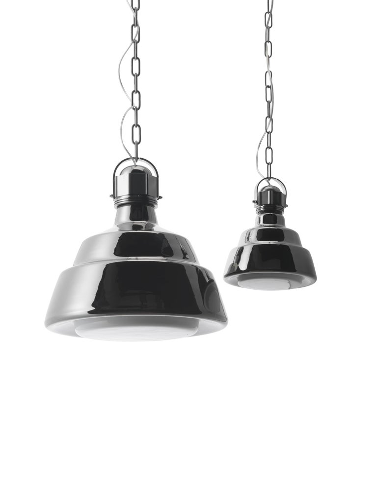 The Glas suspension lamp is the result of contamination between the striking simplicity of industrial settings and the sophisticated appeal of blown glass. The diffuser is hand-made in a single piece and closed on the underside, retaining the shape
