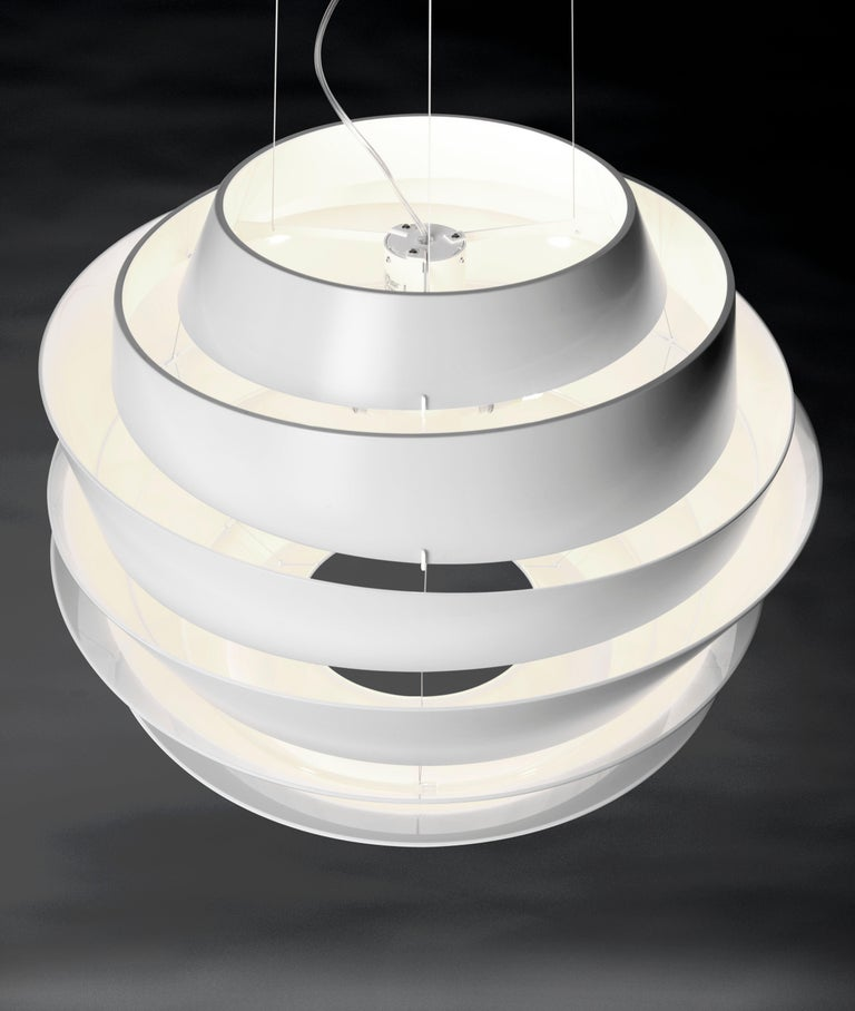 Suspension lamp with diffused and direct light. Diffuser consisting of 6 rings of various diameters and shapes with an oblique cut, made of matt finish injection molded polycarbonate, secured to the epoxy powder coated metal internal frame using 3