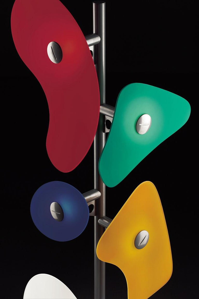 Floor lamp with diffused light. Epoxy powder coated metal tripod central frame and 5 different sized and shaped satin finish colored and painted glass diffusers, which are secured to the frame using epoxy powder coated metal glass-locks. ON/OFF