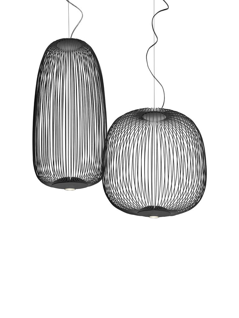 A collection of suspension lamps with two different shapes. The opaque epoxy powder varnished steel spokes are attached to the upper part by two ABS/polycarbonate discs and to the lower part of the aluminum module that acts as the housing and heat