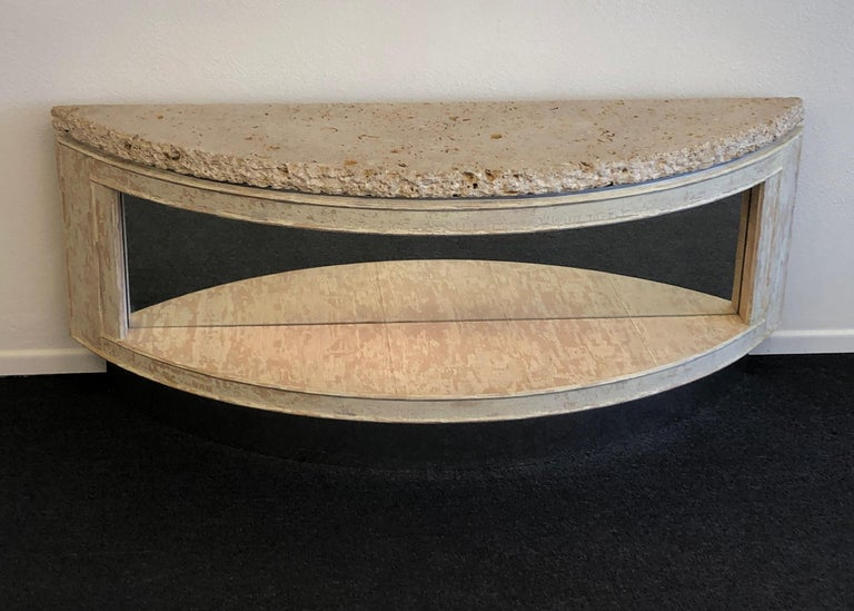 "A beautiful 1980s custom design two tier ""demilune"" console table by Steve Chase. The console was designed for a house in Rancho Mirage. The console is constructed of wood with metal frame to support the heavy 2"" fossil shell top, the bottom tier"