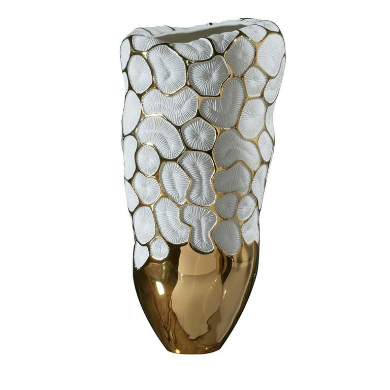 Introduced at Milan Design Week 2019, this superb vase boasts contrasting colors and textures and noble materials for a luxurious effect. It is crafted of unglazed porcelain evident in the minute accents enlivening its body, evocative of madrepore