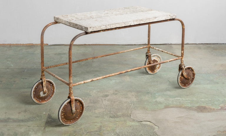 Fossilized stone top green house cart, America, 20th century.  Beautiful rolling cart with thick stone top with embedded fossils, which sits on oversized wheeled legs. Originally from Little Compton, Rhode Island.  This piece ships from