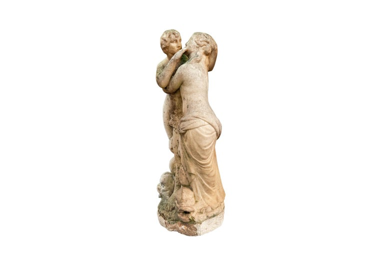 Fountain top with two feminine figures appearing from the mouth of three tritons, Carrara Marble, France, 18th Century.  Measures: Height 71 cm, diameter 27 cm.