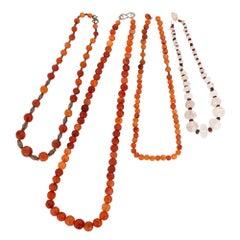 Four 12th Century Islamic Semi-Precious Stone Bead Chains