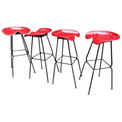 Four 1970s Iron Tractor Seat Stools Manner of Rodney Kinsman