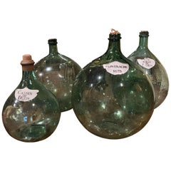 Four 19th Century French Hand Blown Glass Wine Bottles with Decorative Labels