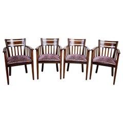 Four 20th Century Oak Armchairs