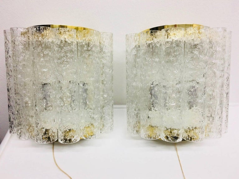 Two chic sleek looking glass tube Sconces by Doria. Each fixture requires two (2) European E14 Candelabra bulbs each up to 40 watts. These beautiful sconces will be shipped directly from Germany to buyer.