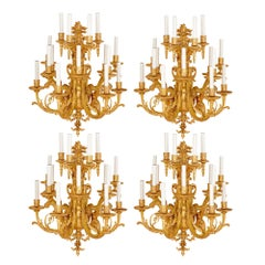 Four Antique Gilt Bronze Fifteen-Light Wall Sconces