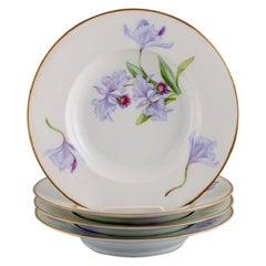 Four Antique Royal Copenhagen Deep Plates in Porcelain with Hand-Painted Flowers