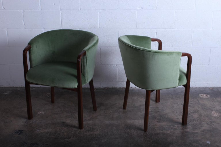 A set of four armchairs/dining chairs by Edward Wormley for Dunbar. Restored walnut frames with new velvet upholstery.
