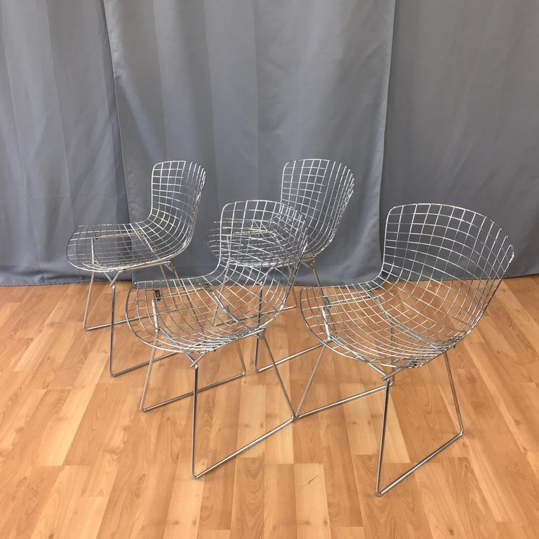 A set of four Bertoia chrome side chair for Knoll. This design was the result of Bertoia's sculpture studies in bending metal rods... their a Classic of Mid-Century Modern design. These are circa 1980s made.
