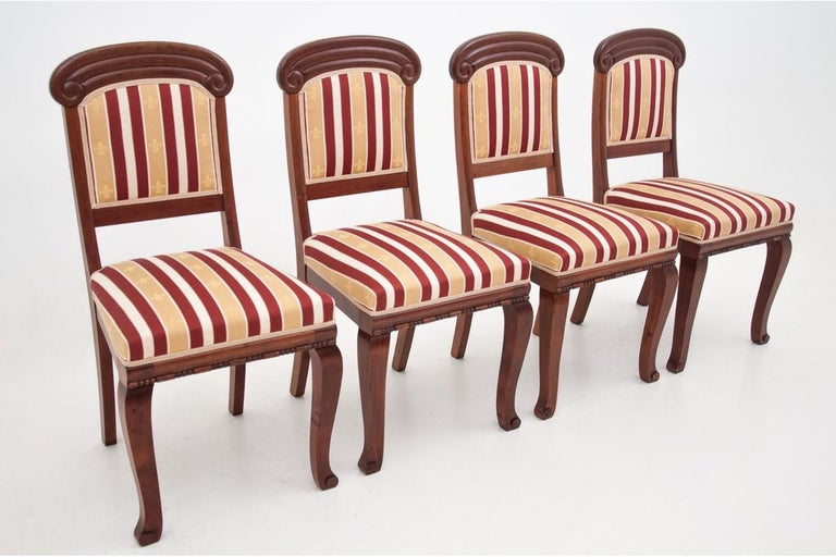 A set of stylish chairs was made of mahogany at the turn of the century. Frames beautifully bent, seats and backs upholstered with elegant fabric. The whole rests on stable legs. Very good condition.  Dimensions:height 96 cm, seat height 46 cm,