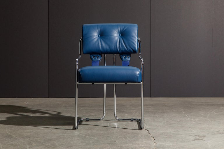 Currently, the most coveted dining chairs by interior designers are 'Tucroma' chairs by Guido Faleschini for i4 Mariani, and we have this incredible set of four (4) Tucroma armchairs in beautiful blue leather with polished chrome frames. The seats