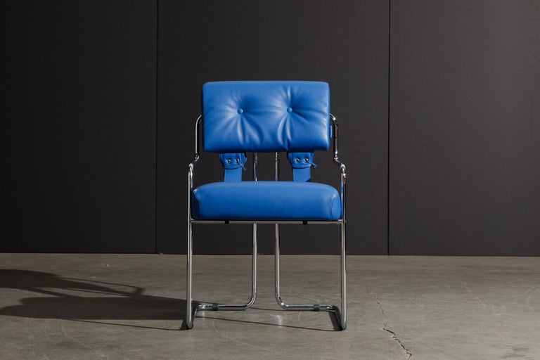 Currently, the most coveted dining chairs by interior designers are 'Tucroma' chairs by Guido Faleschini for i4 Mariani, and we have this incredible set of four (4) Tucroma armchairs in a vibrant electric blue leather with polished chrome frames.
