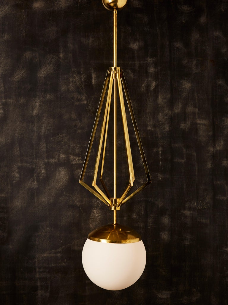 Modern Four Brass Geometrical Suspension with a Large White Glass Globe For Sale