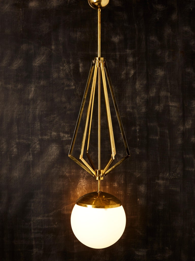 Italian Four Brass Geometrical Suspension with a Large White Glass Globe For Sale