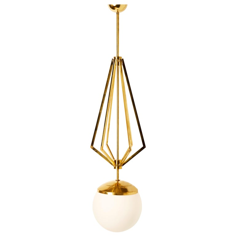 Four Brass Geometrical Suspension with a Large White Glass Globe For Sale