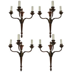 Four Bronzed Neoclassical Three-Branch Sconces