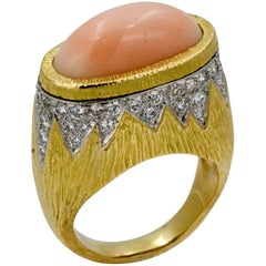 Four Carat Oval East/West Coral 18 Karat Yellow Gold .52 CTW Diamond Ring