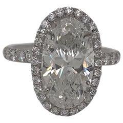 Four Carat Oval Shape Diamond Halo Ring in Platinum GIA H I2