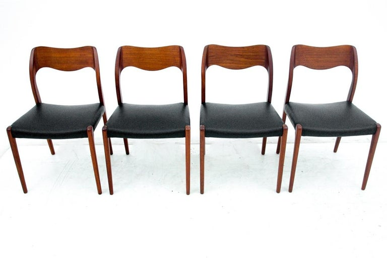 Beautiful dining chairs made of teak wood, upholstered with new high quality Italian leather in black color. Produced in the 1960s in Denmark. Unique design by Niels Otto Møller. Excellent condition. Ideal choice for classic danish design lovers who
