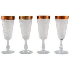 Four Champagne Glasses in Mouth-Blown Crystal Glass with Gold Edge, France 1930s