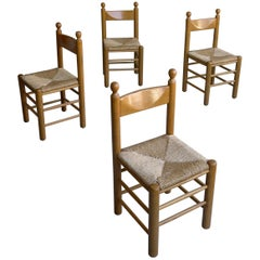 Four Charles Dudouyt Style Chairs in Oak with Rush Seat and Ball Finials, France