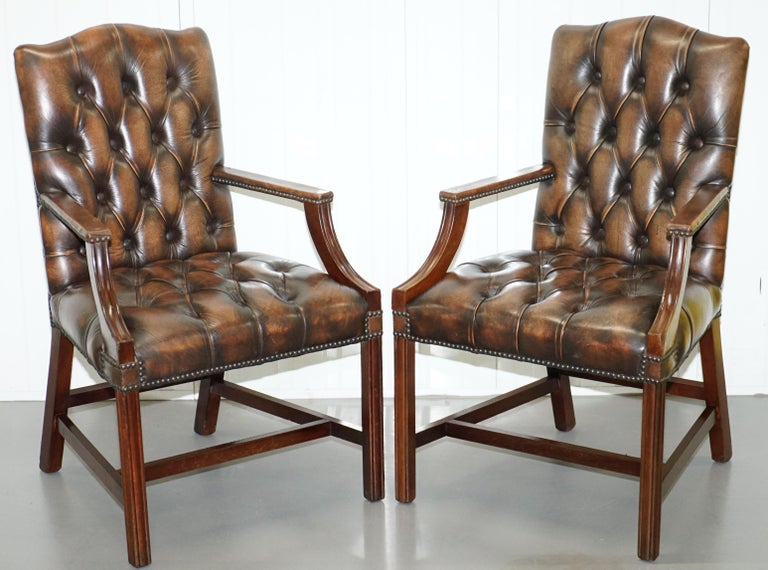 We are delighted to offer for sale this stunning set of four matching Chesterfield high back Gainsborough carver armchairs
