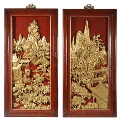 Four Chinese Carved, Lacquered and Gilded Panels