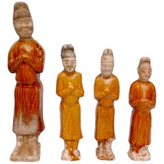 Four Chinese Tang Dynasty Glazed Pottery Court Attendants