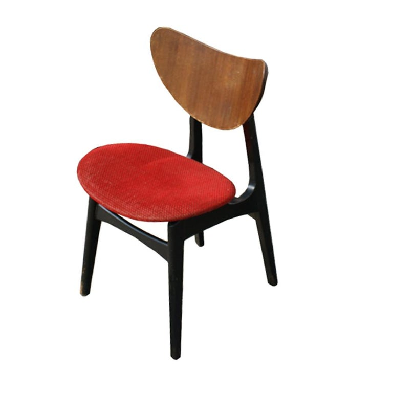 A set of four mid century modern Scandinavian style dining chairs made by G Plan.  Ebonized wooden frame with walnut back and red upholstery.