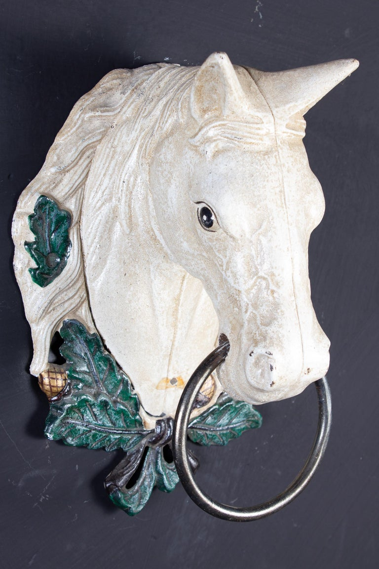 A set of four painted metal horse head sculpture decoration.  Proveniente from a charming Tuscany country estate.  We can sell also separately.