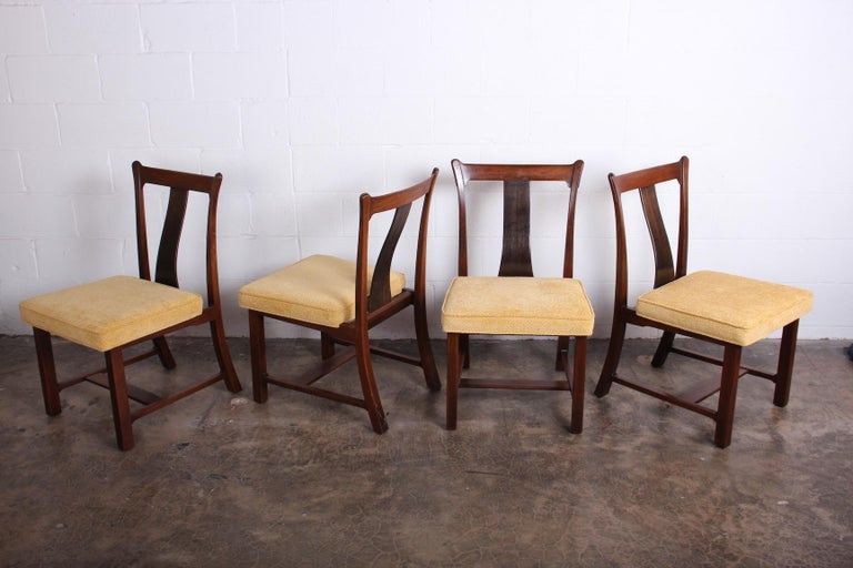 A rare set of four dining / game chairs from the Janus collection known as the Greene & Greene chairs for their crafted details. Designed by Edward Wormley for Dunbar.