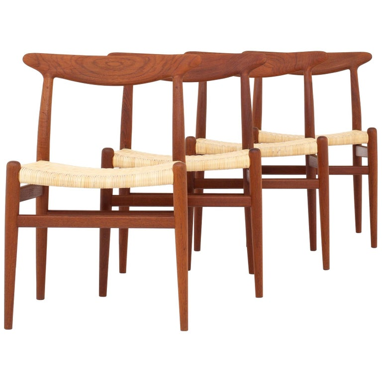 Four Dining Chairs by Hans J. Wegner For Sale
