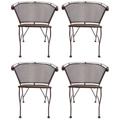 Four Dining Chairs by Salterini