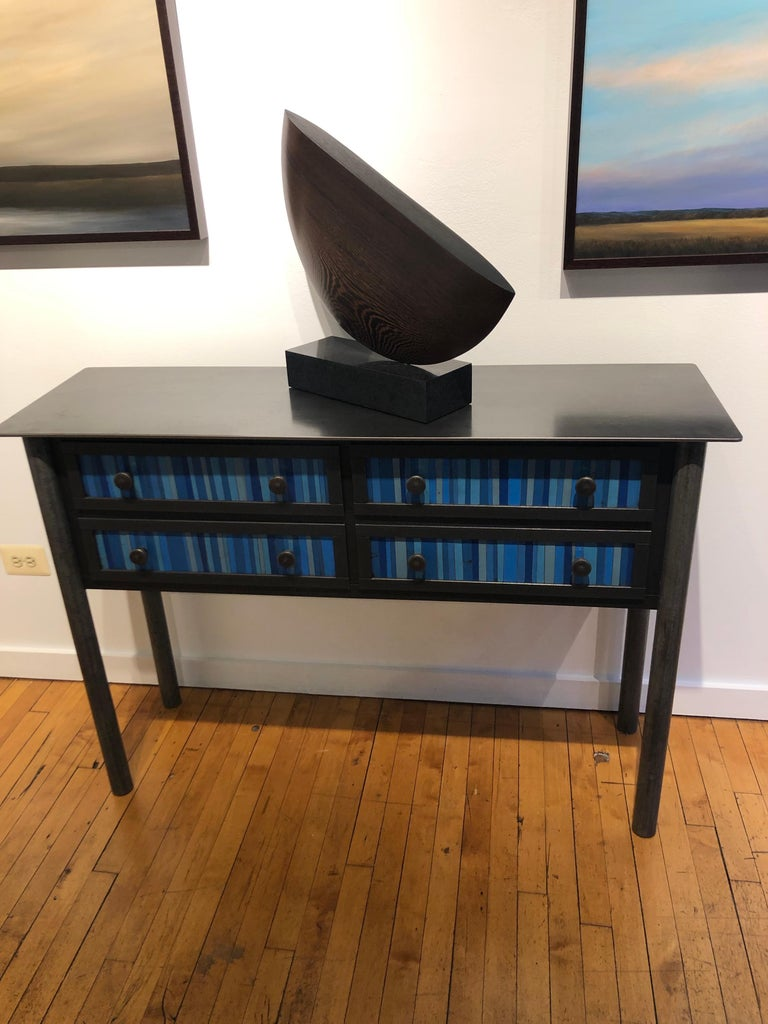 This totally functional modern industrial cabinet is created from hot-rolled steel and found painted panels. The panels on the drawer fronts and sides are created from strips of blue painted salvaged and recycled steel. This unique custom piece is a