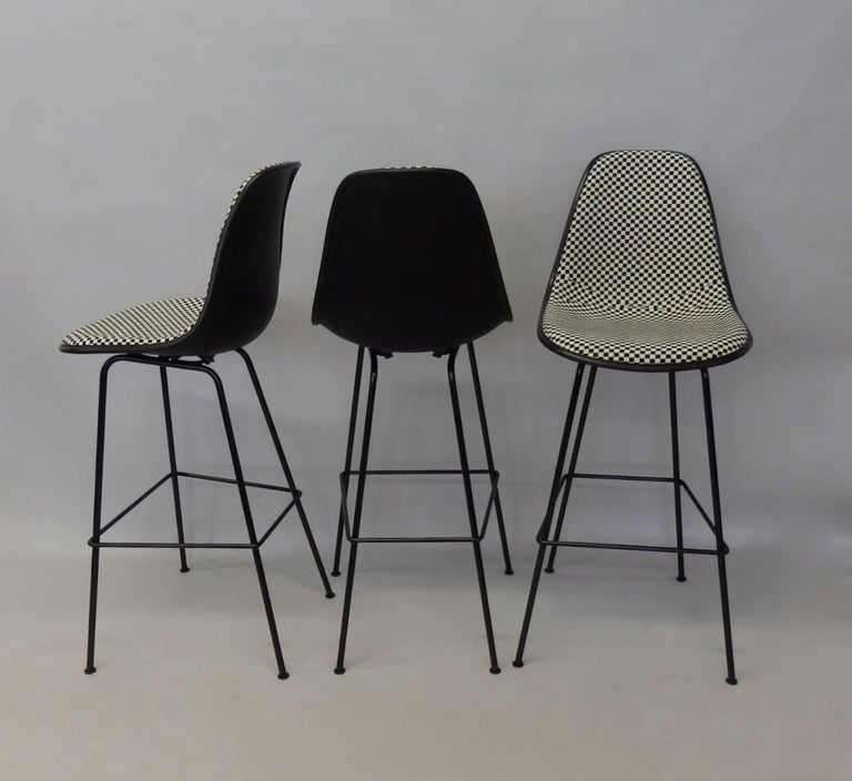 Excellent and basically brand new Eames for Herman Miller barstools. Client bought the set and decided to go in a different direction. I traded them. Never sat in. Great A grade Alexander Girard textile option on the seats. Measure: Seat height at