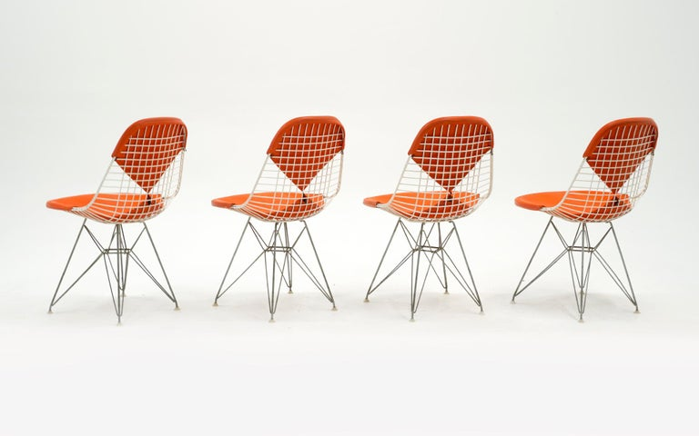 Mid-Century Modern Four Eames White Wire DKR Dining Chairs, Eiffel Tower Base, Orange Bikini Covers For Sale
