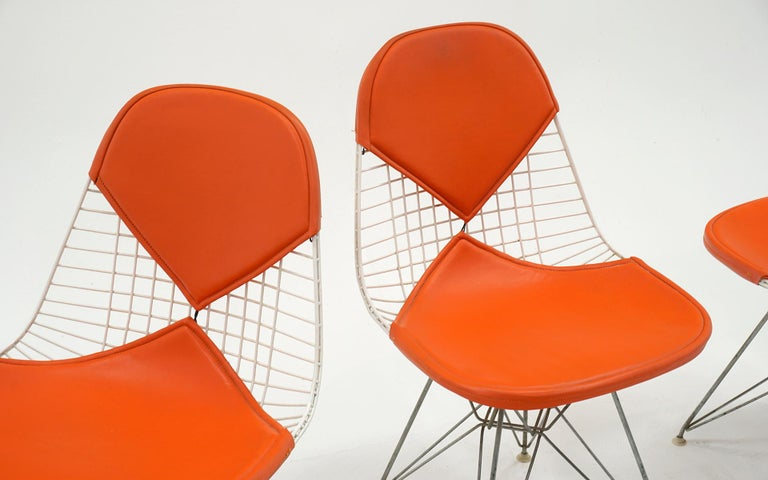 American Four Eames White Wire DKR Dining Chairs, Eiffel Tower Base, Orange Bikini Covers For Sale