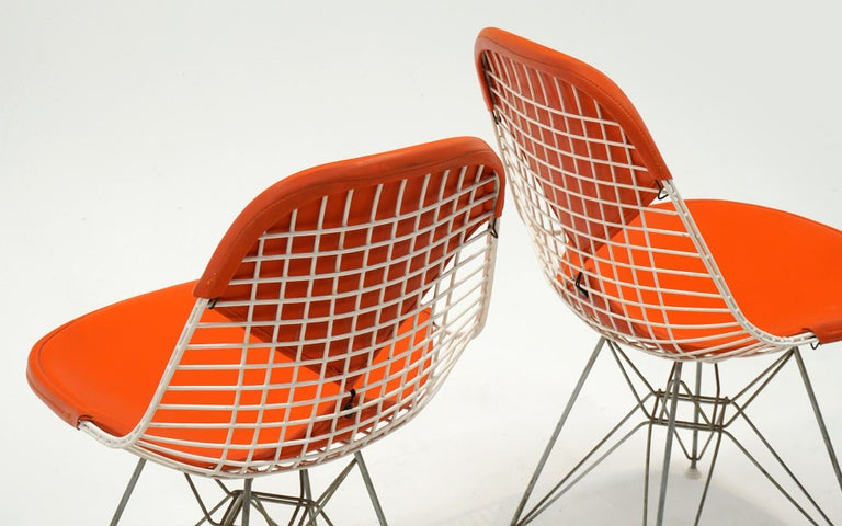 Four Eames White Wire DKR Dining Chairs, Eiffel Tower Base, Orange Bikini Covers In Good Condition For Sale In Kansas City, MO