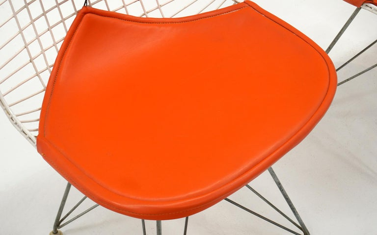 Mid-20th Century Four Eames White Wire DKR Dining Chairs, Eiffel Tower Base, Orange Bikini Covers For Sale