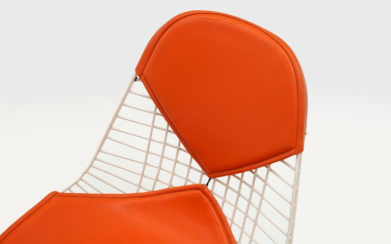 Steel Four Eames White Wire DKR Dining Chairs, Eiffel Tower Base, Orange Bikini Covers For Sale