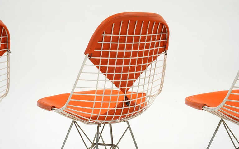 Four Eames White Wire DKR Dining Chairs, Eiffel Tower Base, Orange Bikini Covers For Sale 1