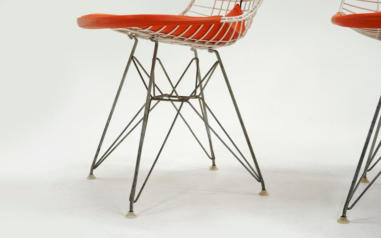 Four Eames White Wire DKR Dining Chairs, Eiffel Tower Base, Orange Bikini Covers For Sale 2